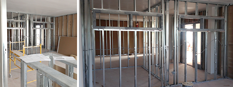 The framing phase of construction at the Industrial office